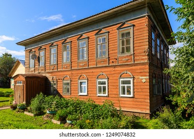 Wooden house with carved polisade in Totma. Russian traditional architecture lies in wooden houses with manually carved decorations, often painted in white.
