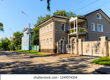 Wooden house with carved polisade in Vologda. Russian traditional architecture lies in wooden houses with manually carved decorations, often painted in white.