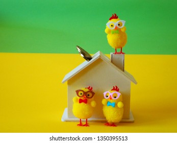 Wooden house with coins and chickens, chicken on chimney