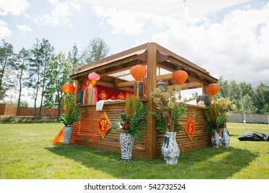 Wooden house decorated with ethnic Chinese lanterns and vases