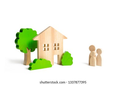 Wooden house and family. Buying a new home. Mortgage and loans. State program of assistance to young families. Subsidy. Quiet and comfortable home in the suburbs. Rental housing, investment.