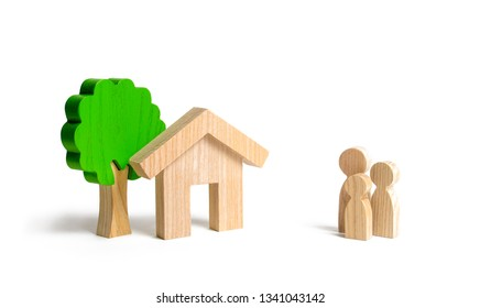Wooden house and family. Buying a new home. State program of assistance to young families. Subsidy. Rental housing, Mortgage and loans. Quiet and comfortable home in the suburbs. investment.