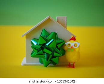 Wooden house as gift, green ribbon and chicken toy, Easter gift