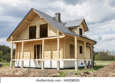 Wooden house with gray tiled roof - under construction.