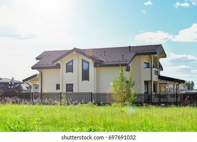 Wooden house with meadow in front of it. Natural photo.