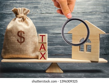 Wooden house and a money bag with the word Tax on the scales. Taxes on real estate, payment. Register of taxpayers for property. Law-abiding citizen. Evasion of payment. Court law. Debts