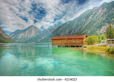 wooden house in a mountain lake HDR