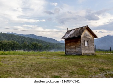 wooden house on a background of a landscape of mountains