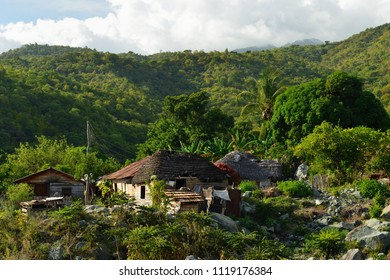 Wooden house in one of villages by the trail for the highest peak on Cuba Pico Turquino being in a mountain range Sierra Maestra on Cuba
