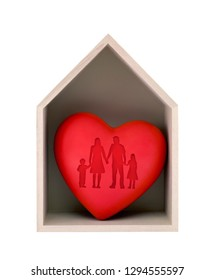 Wooden house and red heart with imprinted family shape isolated on white with clipping path