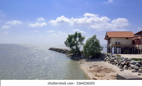 The wooden house and the sea over the blue sky