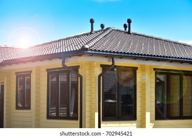 Wooden house and sun beams. Natural photo.