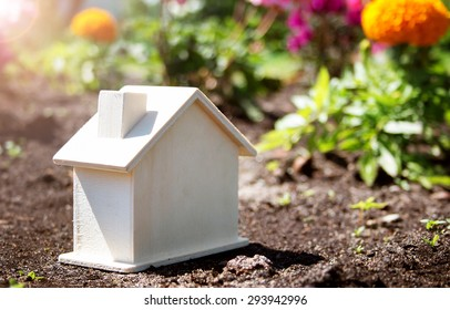 wooden house toy on the grass in garden