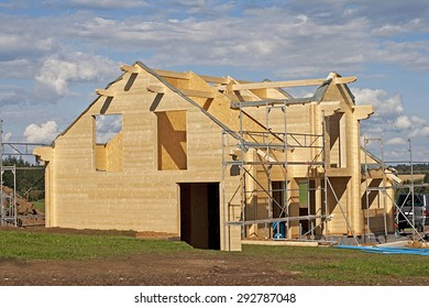 wooden house under construction. family build home