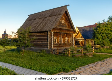 Wooden house and a well in the Museum of wooden architecture in Suzdal, Russia