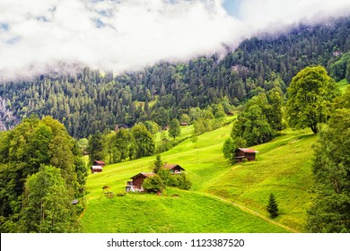 The wooden houses amongst the Swiss Alps.