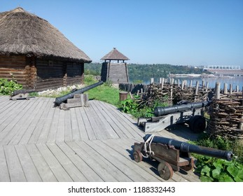 Wooden houses. Wooden buildings on Zaporozhye Sich in Ukraine. Roof made of reeds. Cossack House in Middle Ages