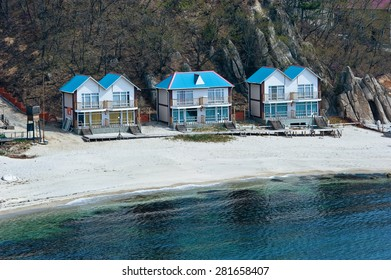 Wooden houses built on the coast. Far East of Russia. East (Japan) Sea.