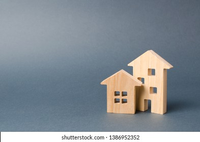 Wooden houses figures. Environmentally friendly and environmentally friendly home. Modern technology in construction. Quiet and cozy, comfortable affordable housing. Housing in the suburbs.