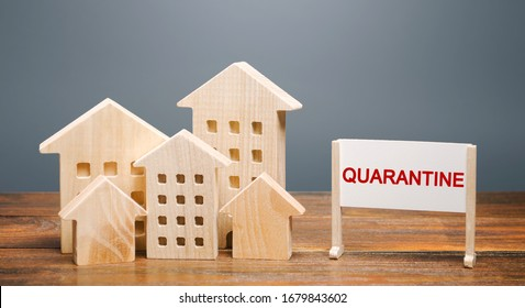 Wooden houses and the inscription Quarantine on an easel. Coronavirus pandemic infection COVID-19. Isolation of people. Obstruction of the spread of the virus. Self isolation