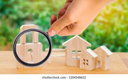 wooden houses with a lock. security in the city / region. Confiscation of property for debts. Safety and alarm system. Buying a new home. saving money for real estate. loan for a mortgage, collateral.