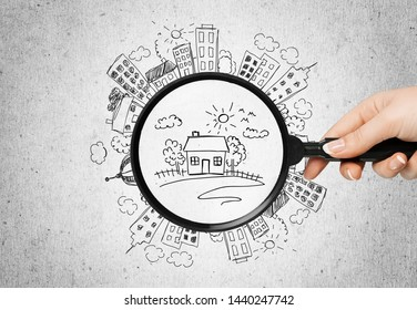 Wooden houses and magnifying glass. Property valuation. Home appraisal. Choice of location for the construction. House searching concept. Search for housing and apartments. Real estate          -