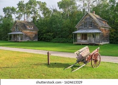 Wooden houses and old wooden wheelbarrow at Val-Jalbert historical village