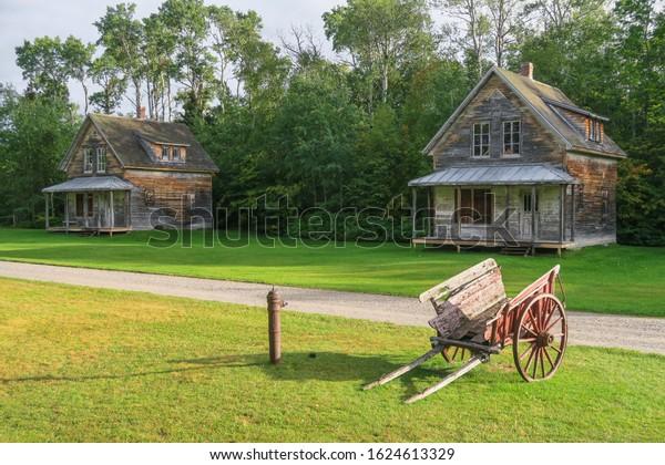 wooden-houses-old-wheelbarrow-valjalbert