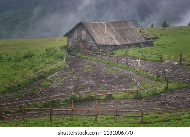 wooden houses on a grass hills at the mountains