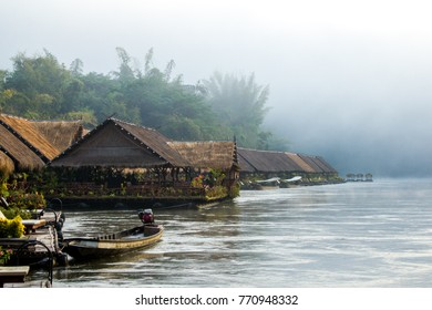 Wooden houses on the water, morning in the jungle, fog, the river Kwai, Thailand.