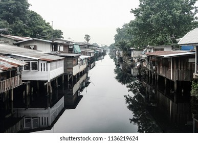 Wooden houses on the waterside at Don Muaeng District in Bangkok, Thailand.