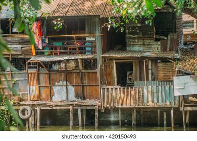 Wooden houses and slums on stills/pylons. Tilt-shift effect. Shallow focus. Travel inspiration.