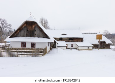 Wooden houses of Vesely Kopec folk museum. Czech rural architecture. Vysocina, Czech Republic. Traditional wooden timbered cottage in winter. Folk open air museum. Most popular place in highlands. - Shutterstock ID 1918242842