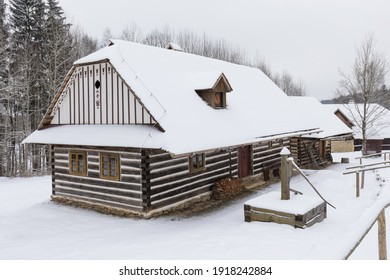 Wooden houses of Vesely Kopec folk museum. Czech rural architecture. Vysocina, Czech Republic. Traditional wooden timbered cottage in winter. Folk open air museum. Most popular place in highlands. - Shutterstock ID 1918242884
