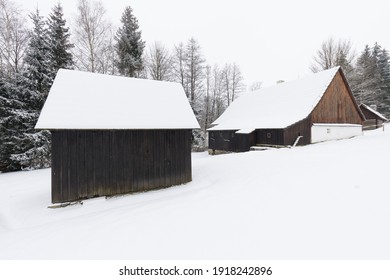 Wooden houses of Vesely Kopec folk museum. Czech rural architecture. Vysocina, Czech Republic. Traditional wooden timbered cottage in winter. Folk open air museum. Most popular place in highlands. - Shutterstock ID 1918242896
