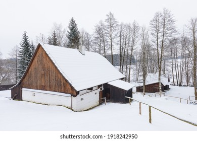 Wooden houses of Vesely Kopec folk museum. Czech rural architecture. Vysocina, Czech Republic. Traditional wooden timbered cottage in winter. Folk open air museum. Most popular place in highlands. - Shutterstock ID 1918242950