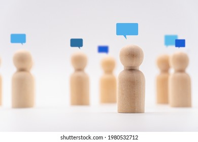 Wooden human icon with bubble icon. Concept for communication and online chat. - Shutterstock ID 1980532712