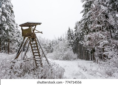 Wooden hunting hide covered with snow in a winter forest