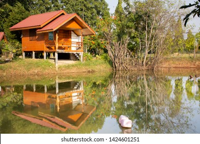 Wooden hut in garden with pond of resort and homestay for thai people and foreigner travelers rent and rest in morning time at  the City of Phraya Lae the Brave in Chaiyaphum, Thailand
