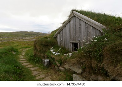 Wooden hut with grass roof at The Sorcerer's Cottage in West Fjords, Iceland