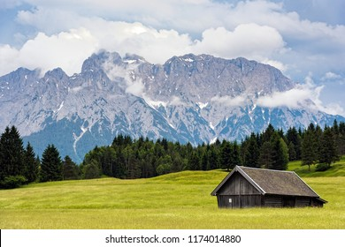 Wooden hut near Zugspitze, the highest mountain of Germany at the Bavarian Alps
