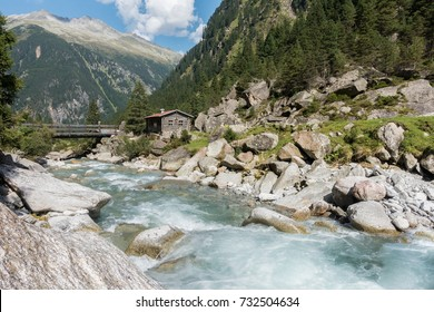 wooden hut on the wild river