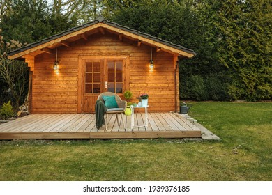 Wooden hut in spring. Drink tea in the garden when the weather is nice. Garden shed for vacation. Nice garden in Germany.