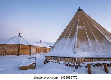 Wooden huts and canvas tent in a permanent Sami winter camp, Tromso region, Northern Norway