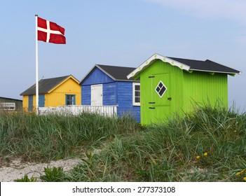wooden huts at danish beach