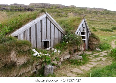 Wooden huts with grass roofs at Sorcerer's Cottage in West Fjords, Iceland