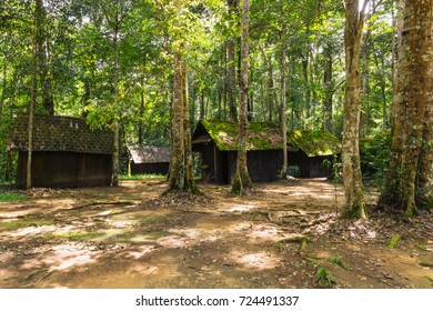 Wooden huts with green moss on the roof in rain forest.