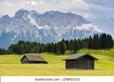 Wooden huts near Zugspitze, the highest mountain of Germany at the Bavarian Alps