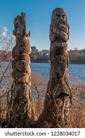 Wooden idols of the Slavic gods. Water in the background. Russia