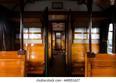 wooden interior of an italian Carrozza Centoporte, early XX century compartment coach for third class passenger trains